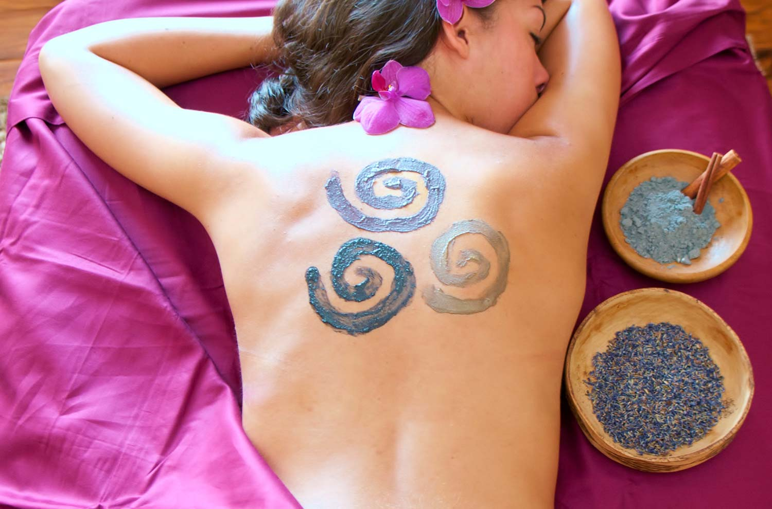 Woman with spirals on her back
